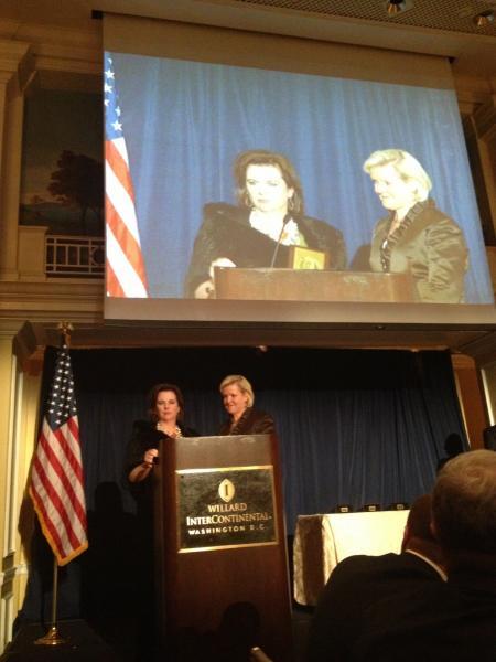 Marjorie accepts award
